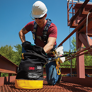 worker looking into dropped object tool bag