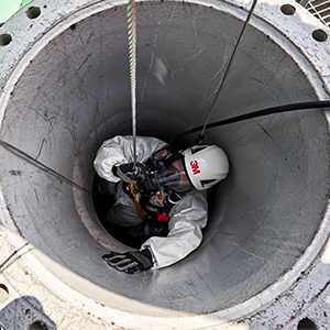 worker performing self rescue in confined space